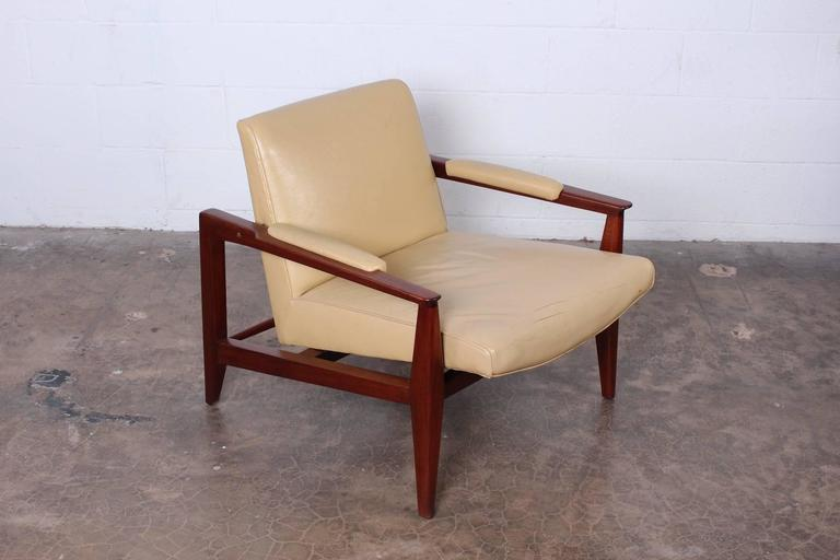 A mahogany lounge chair with original leather upholstery. Designed by Edward Wormley for Dunbar.