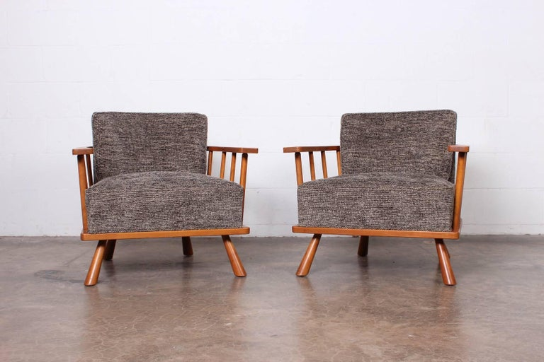 A pair of walnut lounge chairs designed by T.H. Robsjohn-Gibbings for Widdicomb.