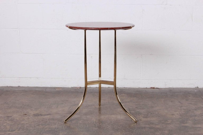 A perfectly polished brass Cedric Hartman side table with Rosso Tranas Rubino granite top, 1979.