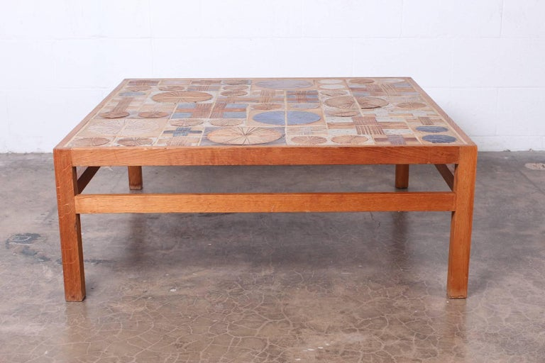 Teak coffee table with inset ceramic tiles by Tue Poulsen & Willy Beck.