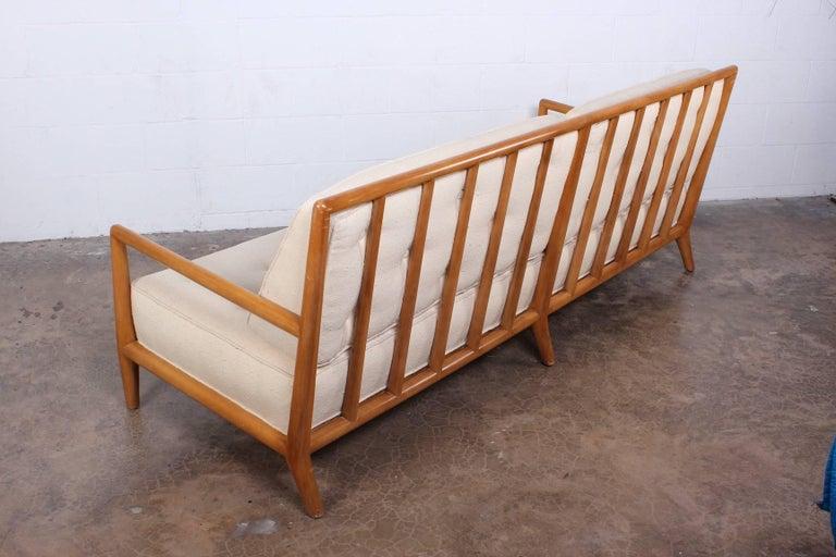A bleached walnut sofa designed by T.H. Robsjohn-Gibbings for Widdicomb.