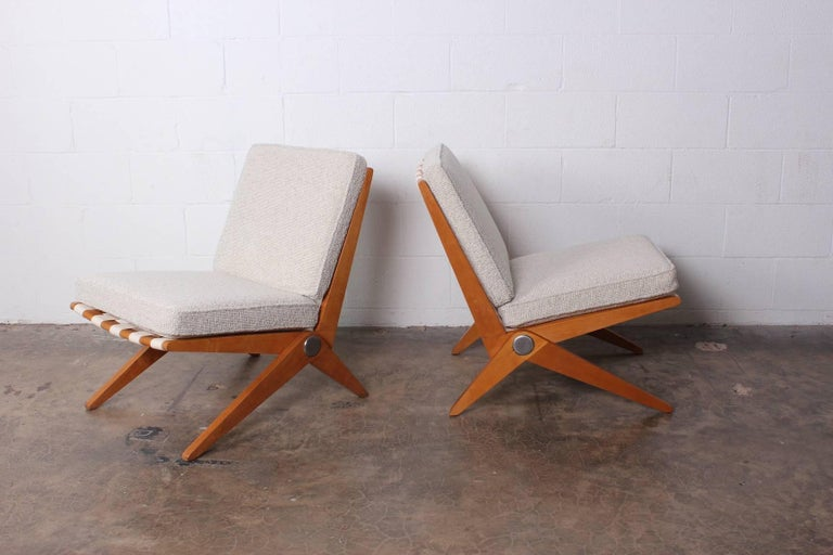 An early pair of knoll scissor chairs designed by Pierre Jeanneret.