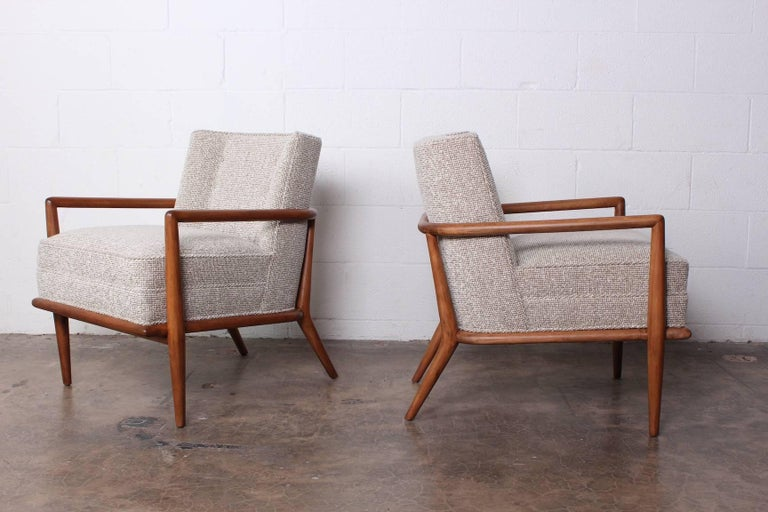 A rare pair of maple lounge chairs with mohair upholstery. Designed by T.H. Robsjohn-Gibbings for Widdicomb.
