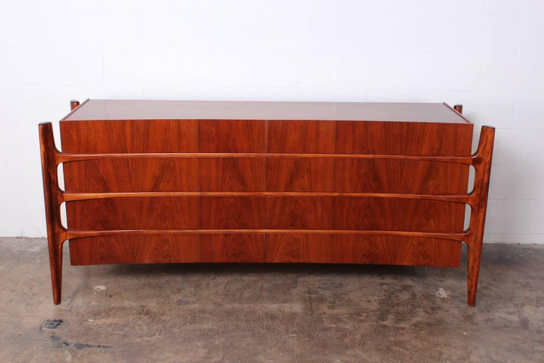 A sculptural walnut eight-drawer dresser designed by William Hinn and made in Sweden by Swedish furniture guild for Urban Furniture.