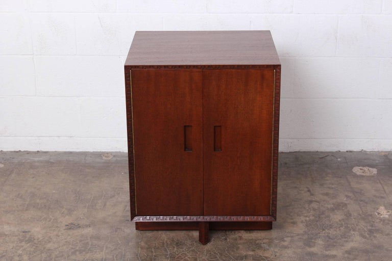 A two-door mahogany cabinet designed by Frank Lloyd Wright for Henredon.