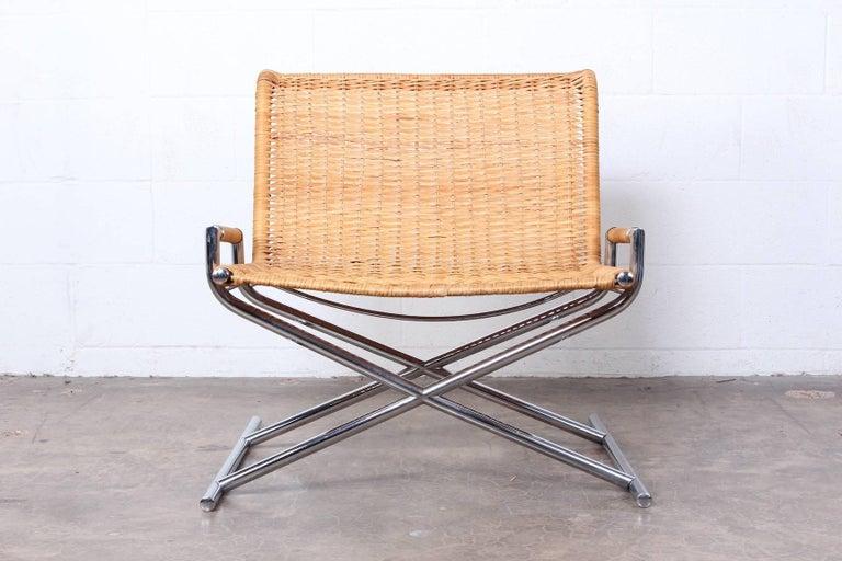A Ward Bennett sled chair by Brickel in cane.