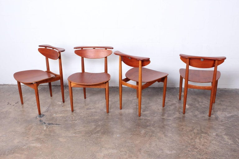 A rare set of four teak and oak dining chairs by Finn Juhl for Bovirke.