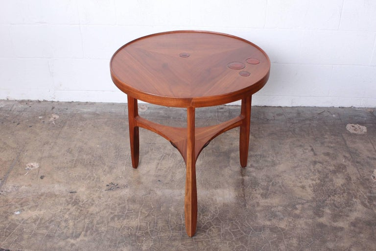A walnut Janus table with inset Natzler ceramic tiles. Designed by Edward Wormley for Dunbar.