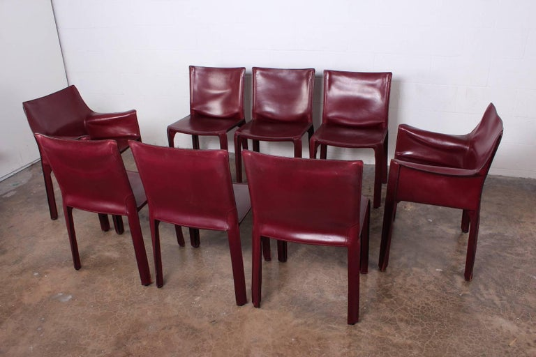A vintage set of eight Oxblood leather Cab armchairs designed by Mario Bellini for Cassina.