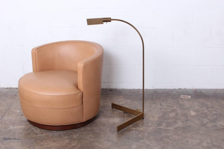 A patinated brass floor lamp by Cedric Hartman.