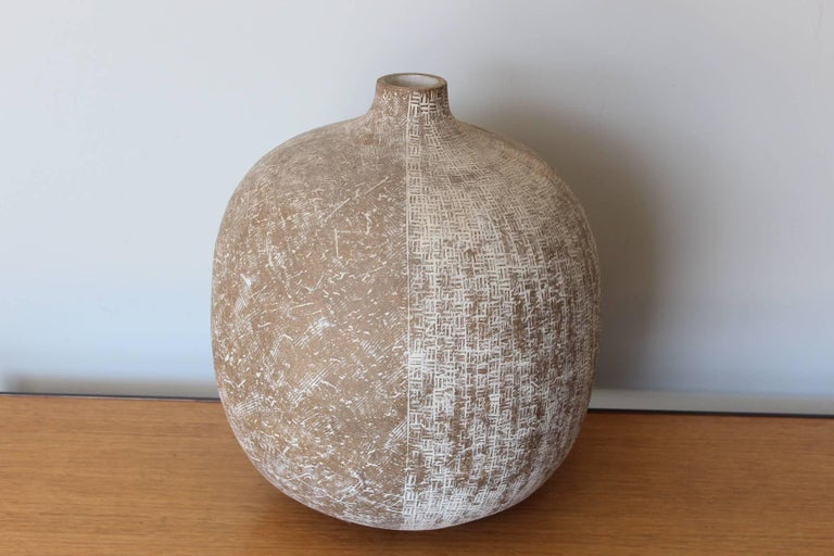 A large ceramic vase by Claude Conover titled