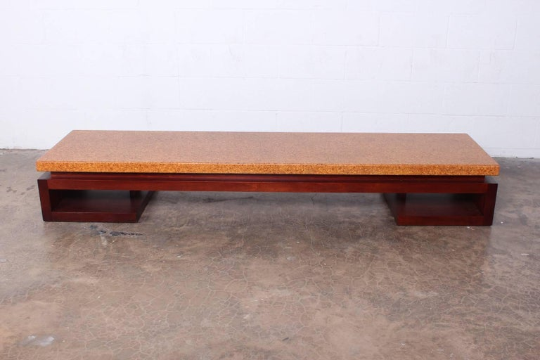 A cork top bench with mahogany base. Designed by Paul Frankl for Johnson furniture.