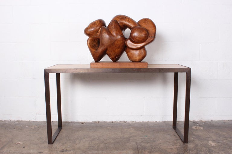 A large wooden abstract sculpture by Robert Wilson.