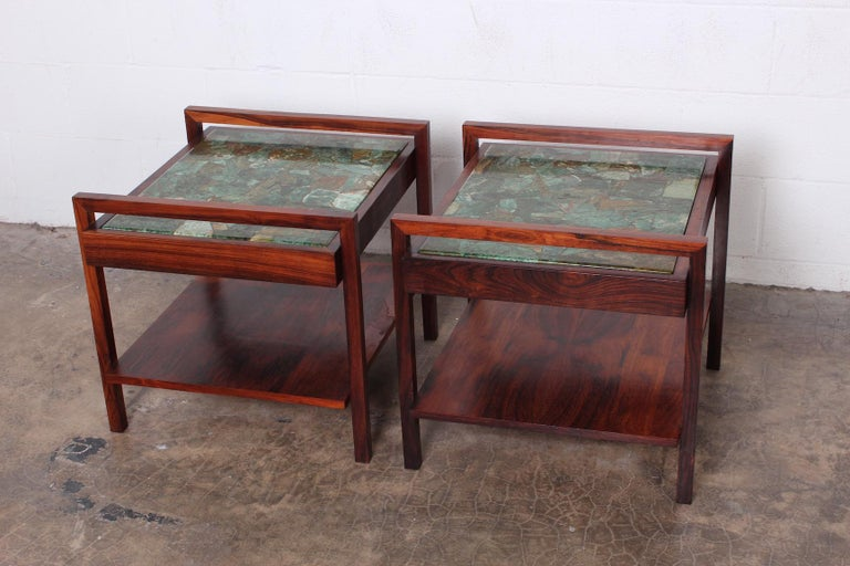 A beautiful pair of solid rosewood tables with green agate tops.