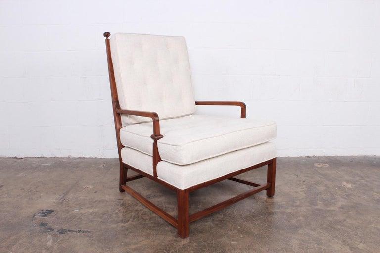 A rare mahogany throne chair designed by Tommi Parzinger for Parzinger originals.