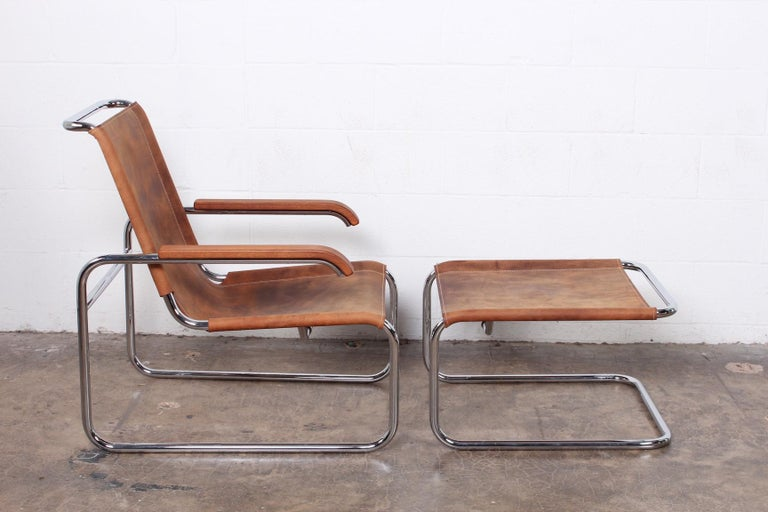 A Marcel Breuer S35 lounge chair and ottoman in Buffalo hide by Thonet.