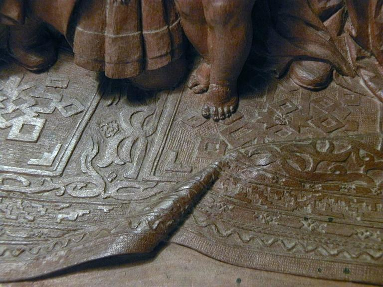Carved 19th century Bas-Relief by Peter Nocker after Hans Holbein's Darmstadter Madonna For Sale