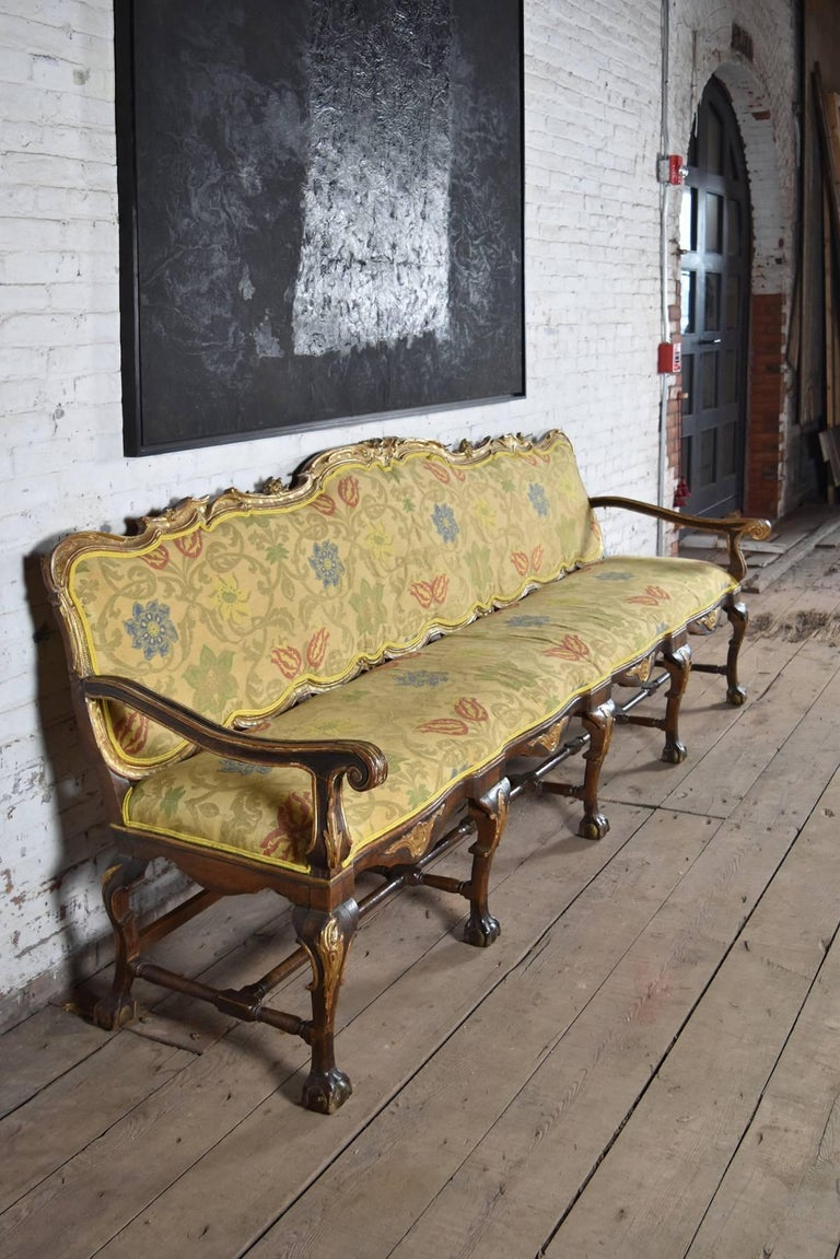 Rococo Long 18th Century Carved and Parcel-Gilt Spanish / Portuguese Settee For Sale