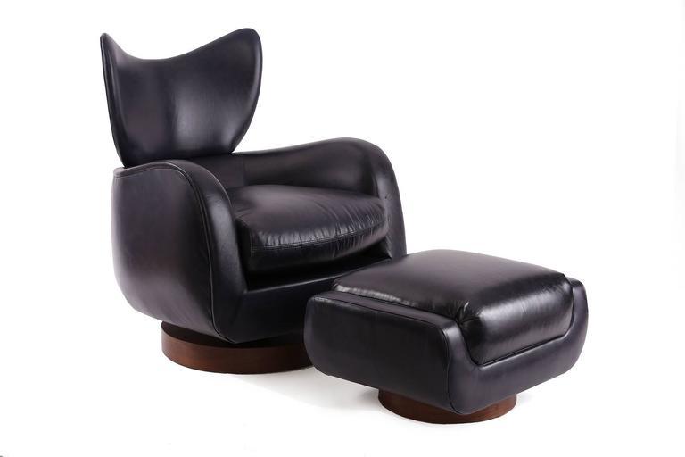 Pair Of Vladimir Kagan Leather And Walnut Swivel Lounge