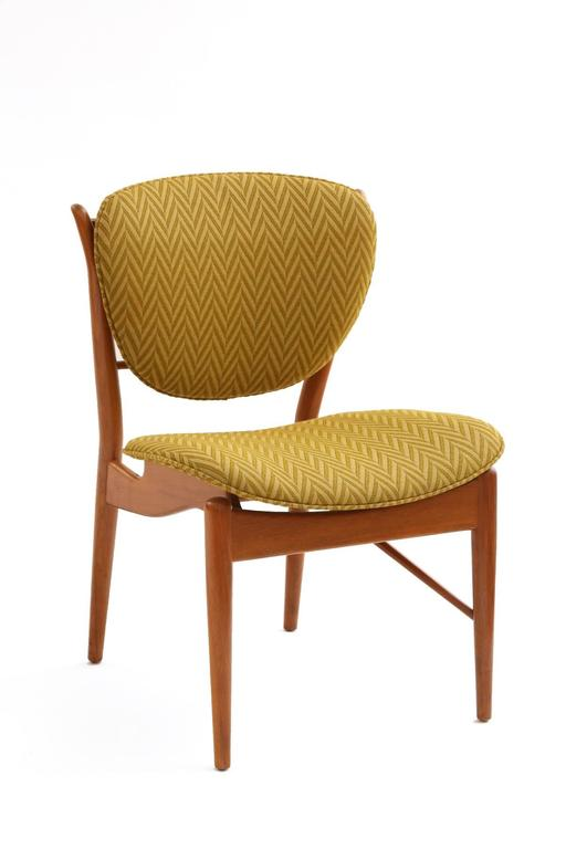 Set of four Finn Juhl 48 dining chairs circa late 1950s. These examples have sculpted teak frames in their original finish and were upholstered in the 1970s in a herring bone textile.