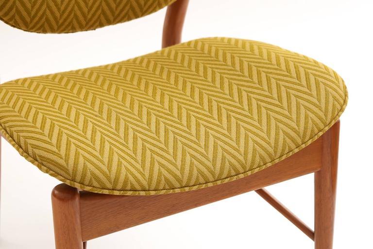 Mid-Century Modern Four Finn Juhl Sculpted Teak Dining Chairs For Sale