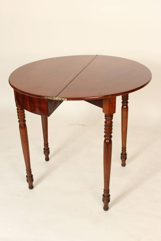 Charles X mahogany Demilune games table, circa 1830. The diameter when the top is opened is 33.5