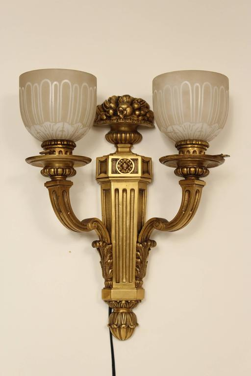 Pair of Louis XIV style gilt bronze two-light wall sconces with acid etched glass shades, circa 1920.