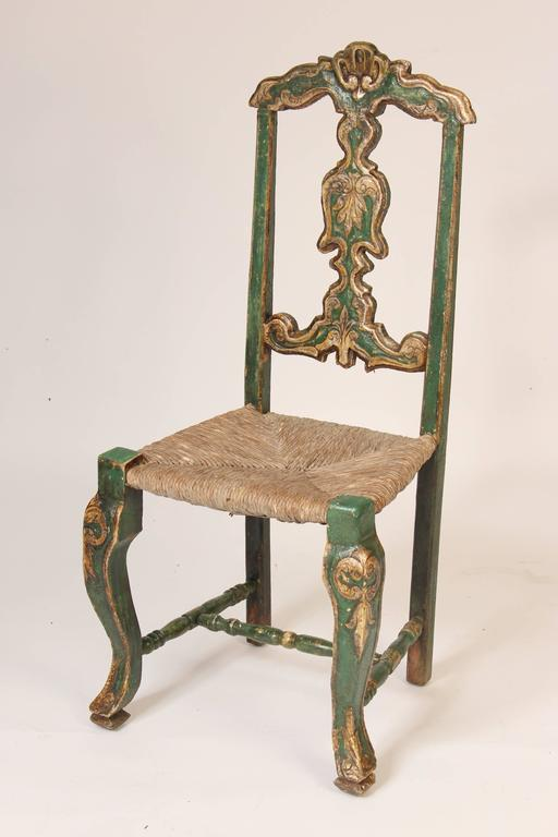 Set of six green painted and silver leaf continental (probably Spanish or Portuguese) dining room chairs with rush seats, 19th century.