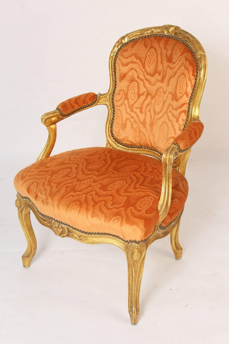 Pair of Louis XV style giltwood armchairs, late 19th century.