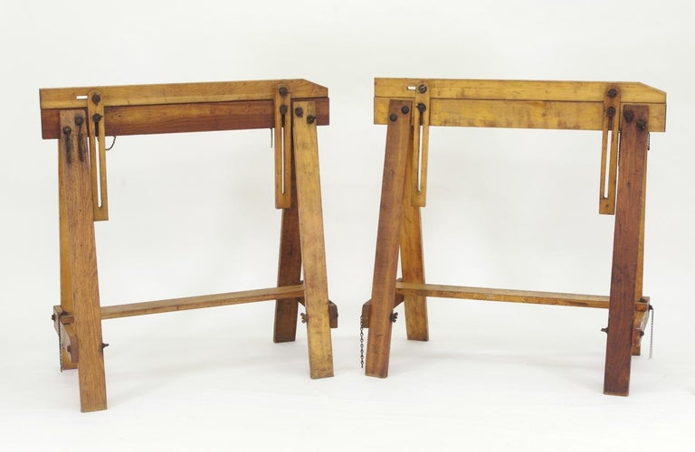 Pair of vintage adjustable saw horses, each fastened together with iron wing-nuts and bolts. The white stenciling reads on the left horse in the lead photo reads,