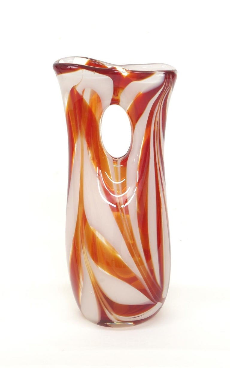 Murano glass vase, orange/red and white candy stripe glass in a clear matrix. Unsigned, with a polished pontil.  This cheerful vase draws its inspiration from ancient glass cosmetic tubes or 'kohl tubes'. Kohl was a black makeup used as eyeliner