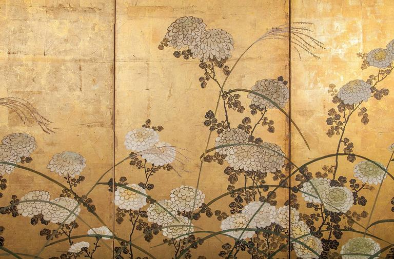 Japanese Screen White Chrysanthemums and Wild Grasses.  Chrysanthemums, or kiku, are the official symbol of imperial Japan.  The flower is also a symbol of national identity.  White chrysanthemums are thought to be particularly good luck, and here