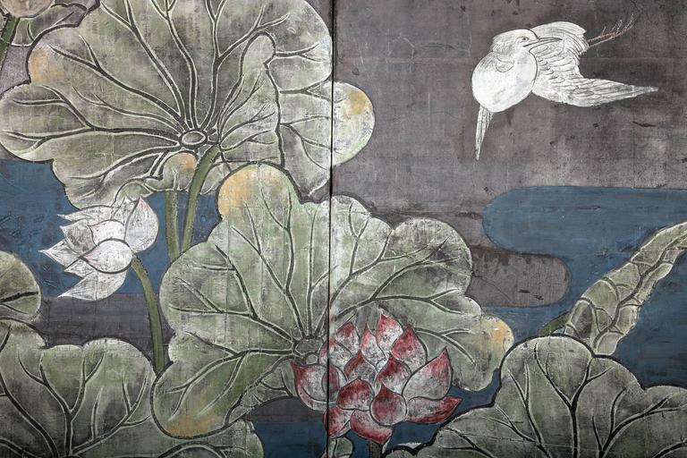 Japanese two panel screen, lotus and heron Colored mineral pigments on silver leaf on handmade mulberry paper.