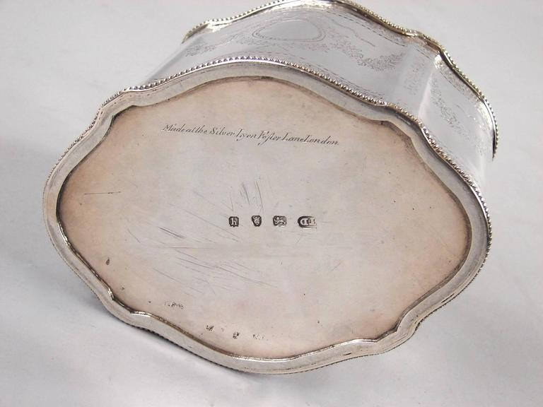 A fine English George III period sterling silver tea caddy of shaped oval form with bright cut decoration fully hallmarked for London 1783-4 by Thomas Daniell and signed in script