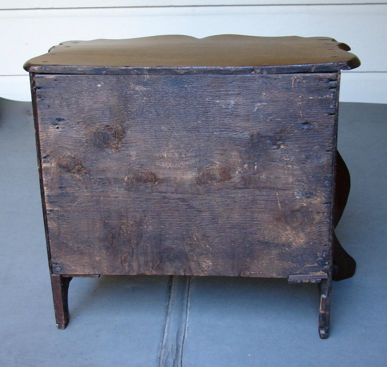 A miniature French mahogany bombe 3-drawer commode, each graduated drawer now lined. 19th century. One handle replaced.