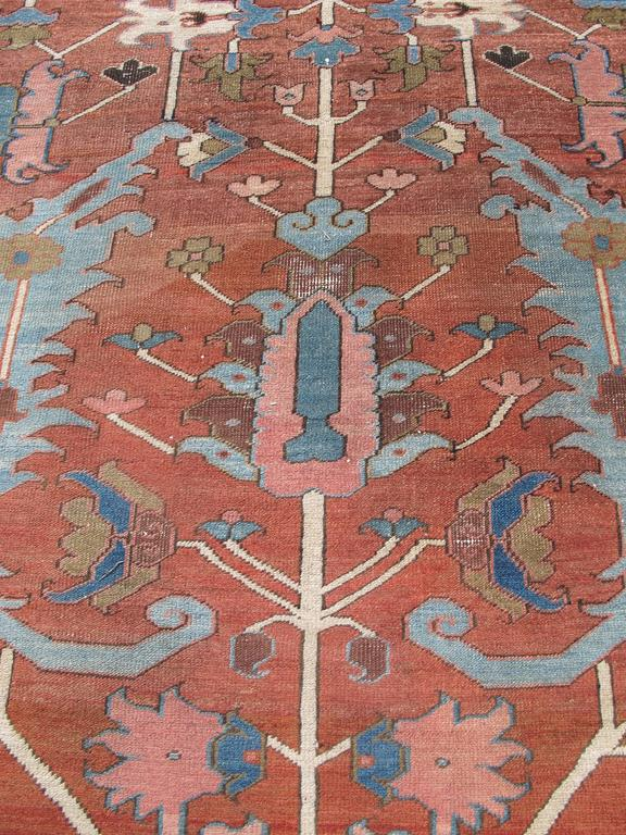 Hand-Woven Late 19th Century Red Serapi Heriz Carpet with Central Indigo Octagon For Sale