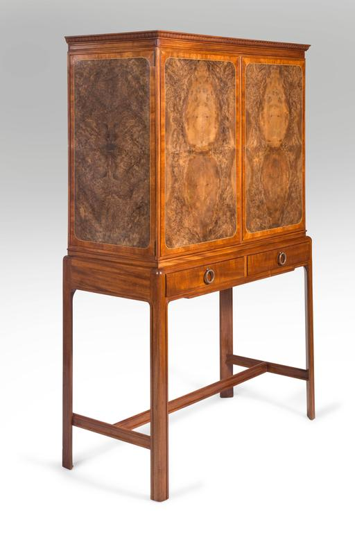 David Blomberg, Swedish Mahogany and Burl Walnut Cabinet on Stand Handsomely designed, superb burlwood and beautifully detailed. The rectangular top with a leaf-tip molding, above two doors and side panels each inlaid with burled-walnut, the stand
