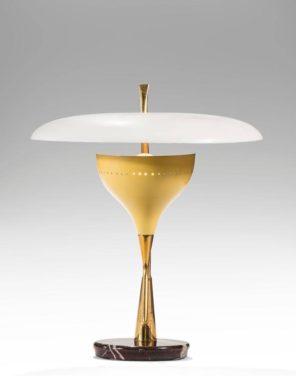 This choice lamp defines mid century Italian design at its best. The circular white shade above a pale yellow light holder both raised on angled brass supports, with a reverse beveled circular marble base. All materials of very good quality