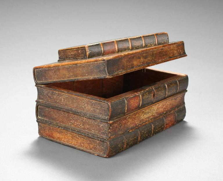 Delightful, clever tromp l'oeil box created to resemble a stack of old books.  Illustrated, Antiquities and Collecting magazine, Book Form Furniture, June 2008, p. 39.  Wonderful mellow antique condition with lovely aged patina, ready to add to your