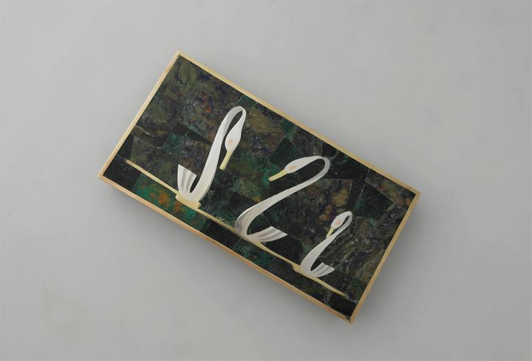 Being offered is a circa 1960 decorative box by Los Castillo of Taxco, Mexico. Entirely hand wrought piece made of copper, brass and sterling silver. Azur malachite stone inlay on the hinged lid and body of box; wooden interior. Dimensions: 8