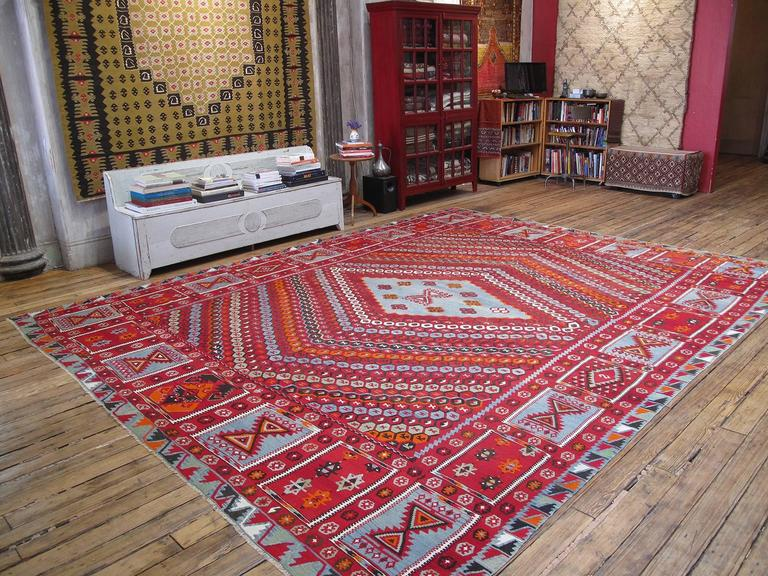 A great example of large-format Kilim weaving tradition from this prolific region, with a refined rendition of the so-called honeycomb design and a rare border. In excellent, almost unused, condition despite its age. One of our most exciting recent