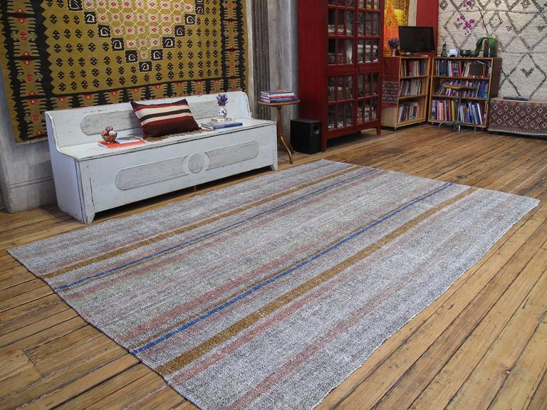 An old flat-weave from Central Turkey, woven with an ingenious mixture of colorful cotton rag and goat hair and used as a sturdy, everyday floor cover in the weaver's household. Great modern appeal with its harmonious color palette and simple