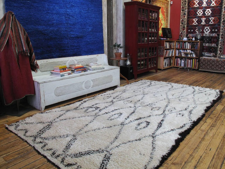The real deal! The artistry with which the Classic Berber grid pattern is interpreted makes this carpet stand out from the seemingly endless supply of white Moroccan rugs in the market. The weave is very dense and the wool is of excellent