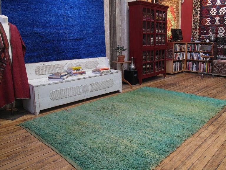 Green Moroccan Berber rug. A lovely old, sun-faded green Berber rug from the Middle Atlas Mountains.