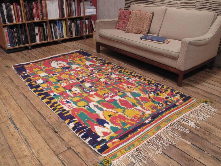 Azilal Moroccan Berber rug. A very cheerful example of Moroccan Berber weaving from the High Atlas Mountains, where authentic weaving traditions - as opposed to commercial weaving - survive to this day. Chaotic at first sight, it takes a while to