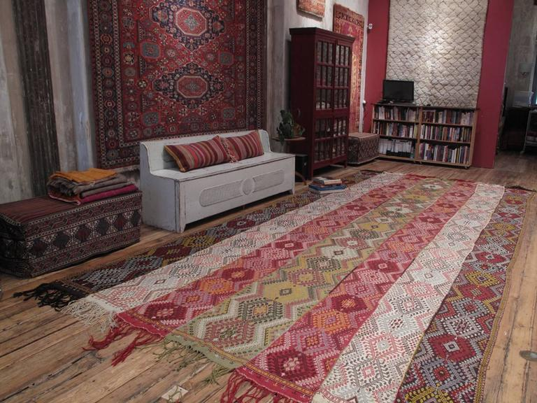 """A very impressive example of Anatolian tribal art, this is a """"pardah,"""" a curtain or tent divider that hung sideways in the home of the weaver. It is not hard to imagine a tribal chief proudly sitting in front of it while receiving his guests. Woven"""
