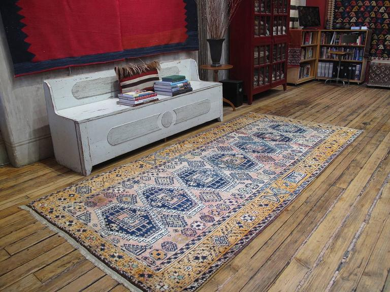 Kurdish rug. A lovely vintage Kurdish rug in the typical long format. Glossy wool, unusual color palette.