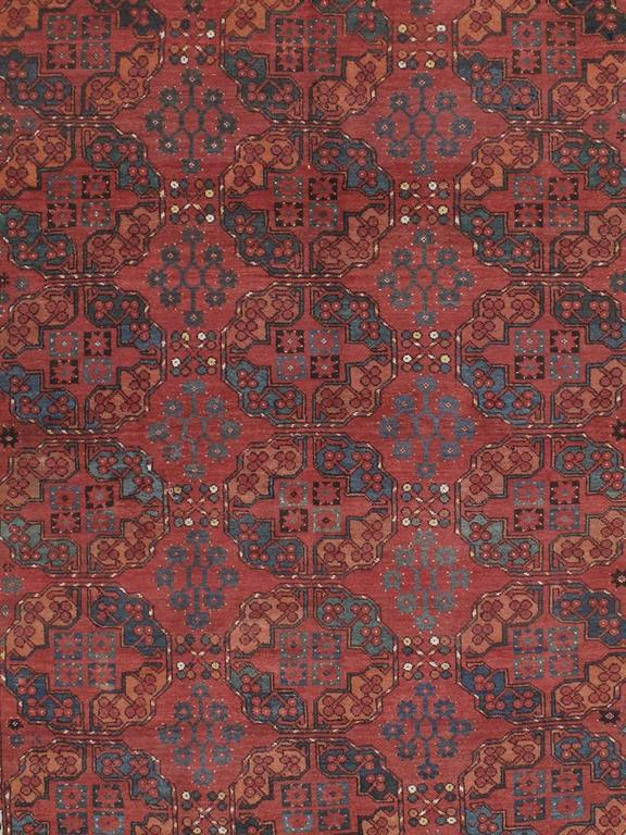 Antique Ersari Main carpet or rug. An antique tribal carpet from Central Asia attributed to the Ersari Turkmen. Deeply saturated colors, dominated by rich madder reds, repetitive heraldic symbols, called