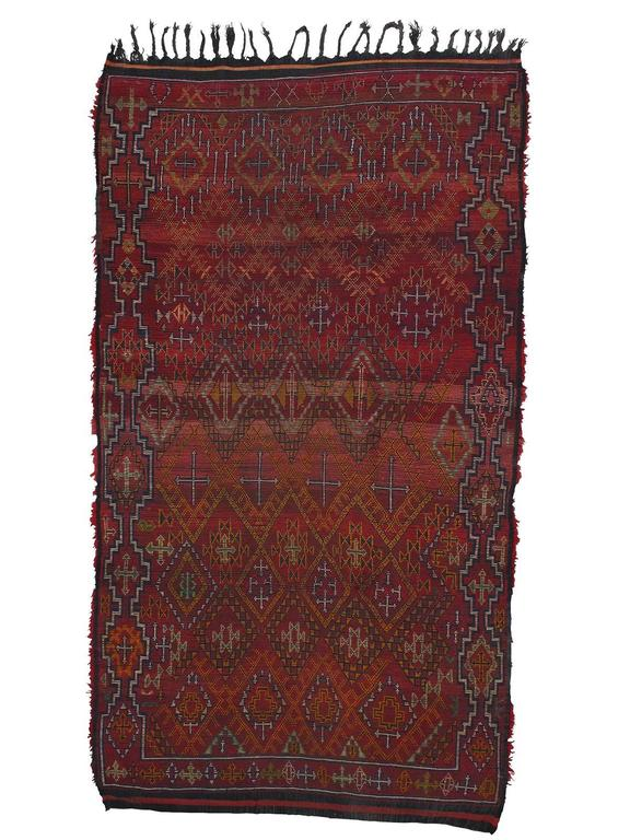An amazing Moroccan Berber carpet from the Middle Atlas Mountains. The very dense and well-preserved pile hides a complex tribal design that is only visible on the back. (See second image.) Such carpets were used as beds by the weaver's family. No