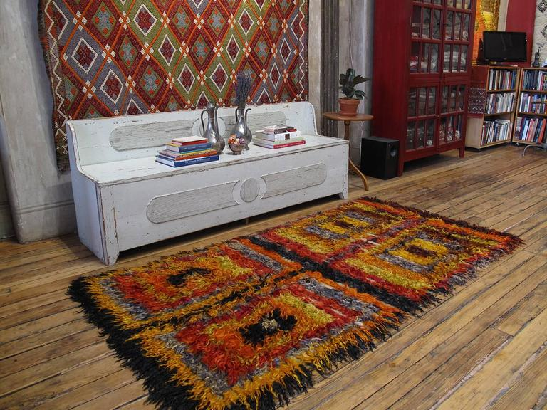 Four Squares, Angora Tulu rug. An old tribal rug from West Central Turkey, coarsely woven with long strands of colorful angora goat hair (mohair). Such rugs were used as beds, blankets and wall covers to provide warmth and comfort in village homes.
